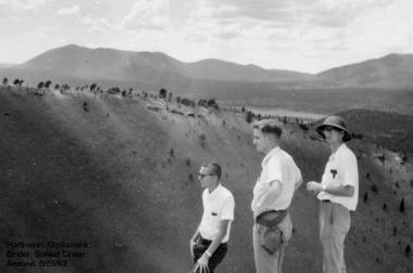 William Hartmann, Dale Cruikshank and Alan Binder – all graduate students studying under Kuiper – stand on the rim of Sunset Crater near Flagstaff, Arizona on August 25, 1963.