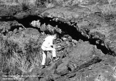Dale Cruikshank, who studied under Kuiper as a graduate student, crawls among McCarty's Lava Flow Field in New Mexico c. 1964.