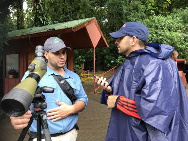 Alex Muñoz, a former journalism undergraduate student, conducts an interview in Spanish in Costa Rica as part of the journalism school's study abroad program.