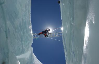 Levine crosses a crevasse in the Khumbu Icefall during an ascent up Mount Everest.